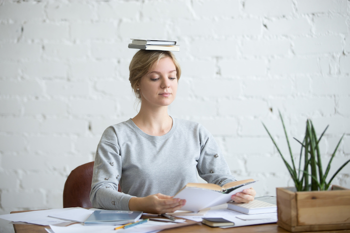 posture exercises- balancing book on head