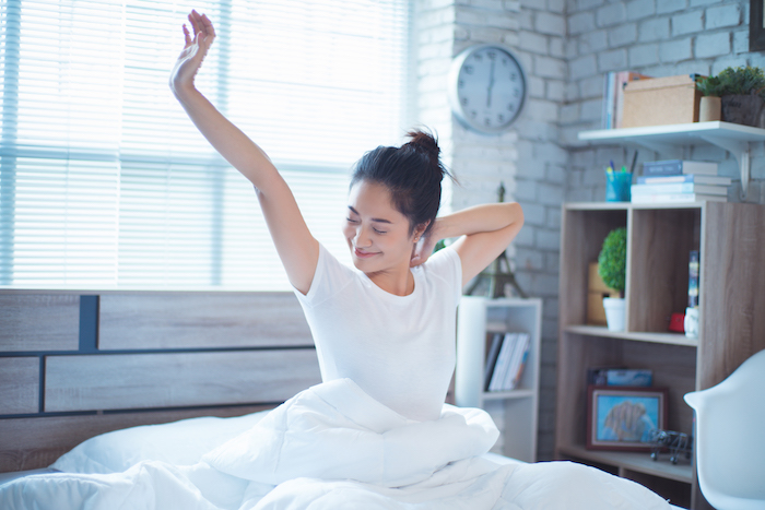 be the best you - stick to routine woman waking up