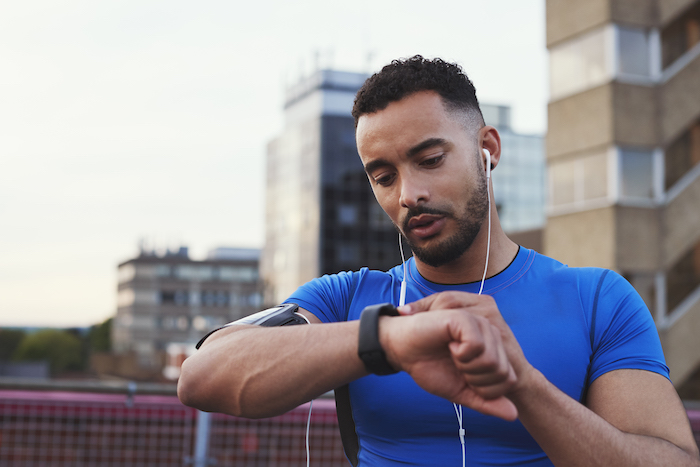 how to start running - man looking at smart watch