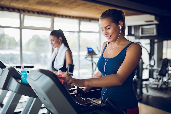 cool down exercises - woman on treadmill