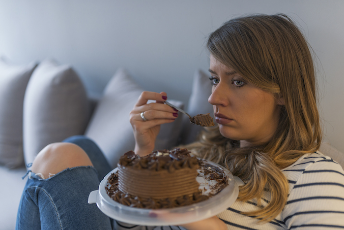 how to stop eating sugar- woman eating cake