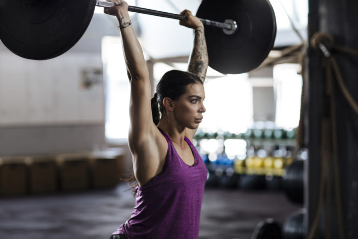building arm muscle- woman lifting