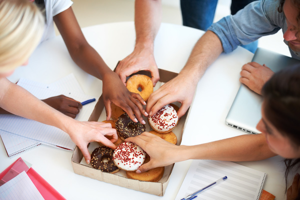 the effects of sugar and skin - hands reaching for donuts