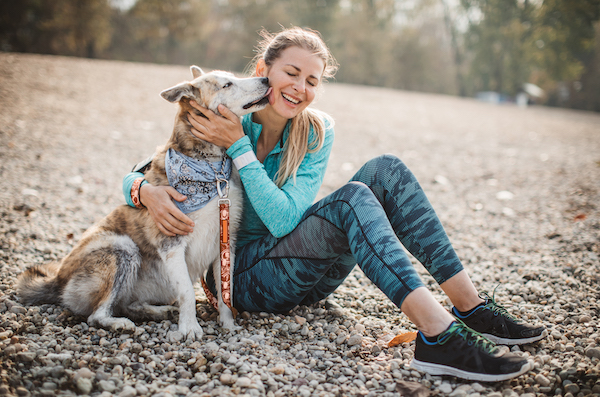 dogs help you live longer- woman and dog