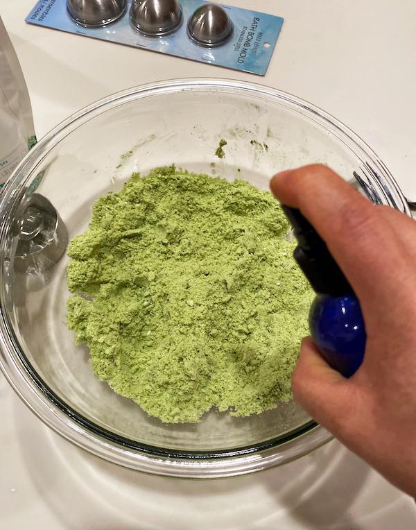 grinch bath bomb- adding oil