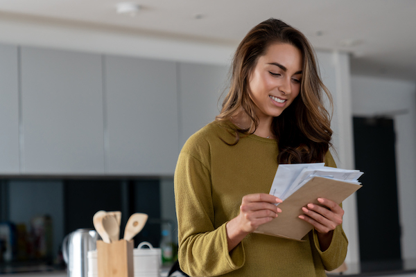 christmas fitness- woman checking mail