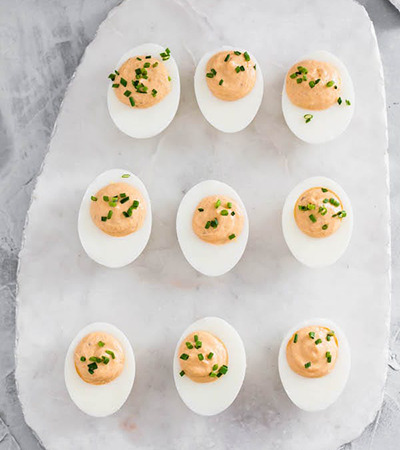 9 deviled eggs on countertop | game day appetizers