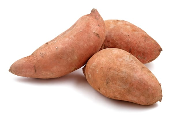 are sweet potatoes healthy - sweet potatoes on white