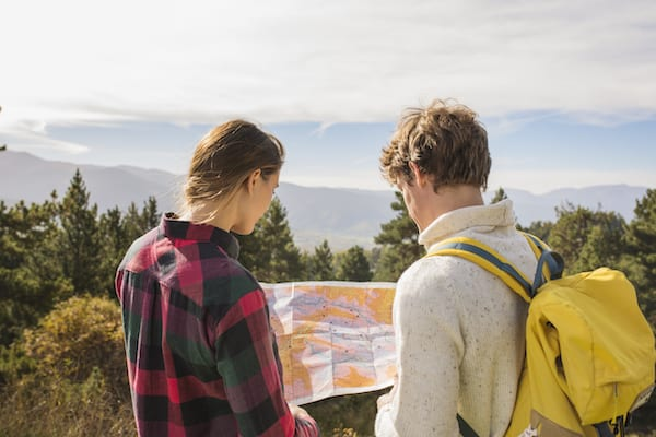 hiking essentials - hikers looking at map