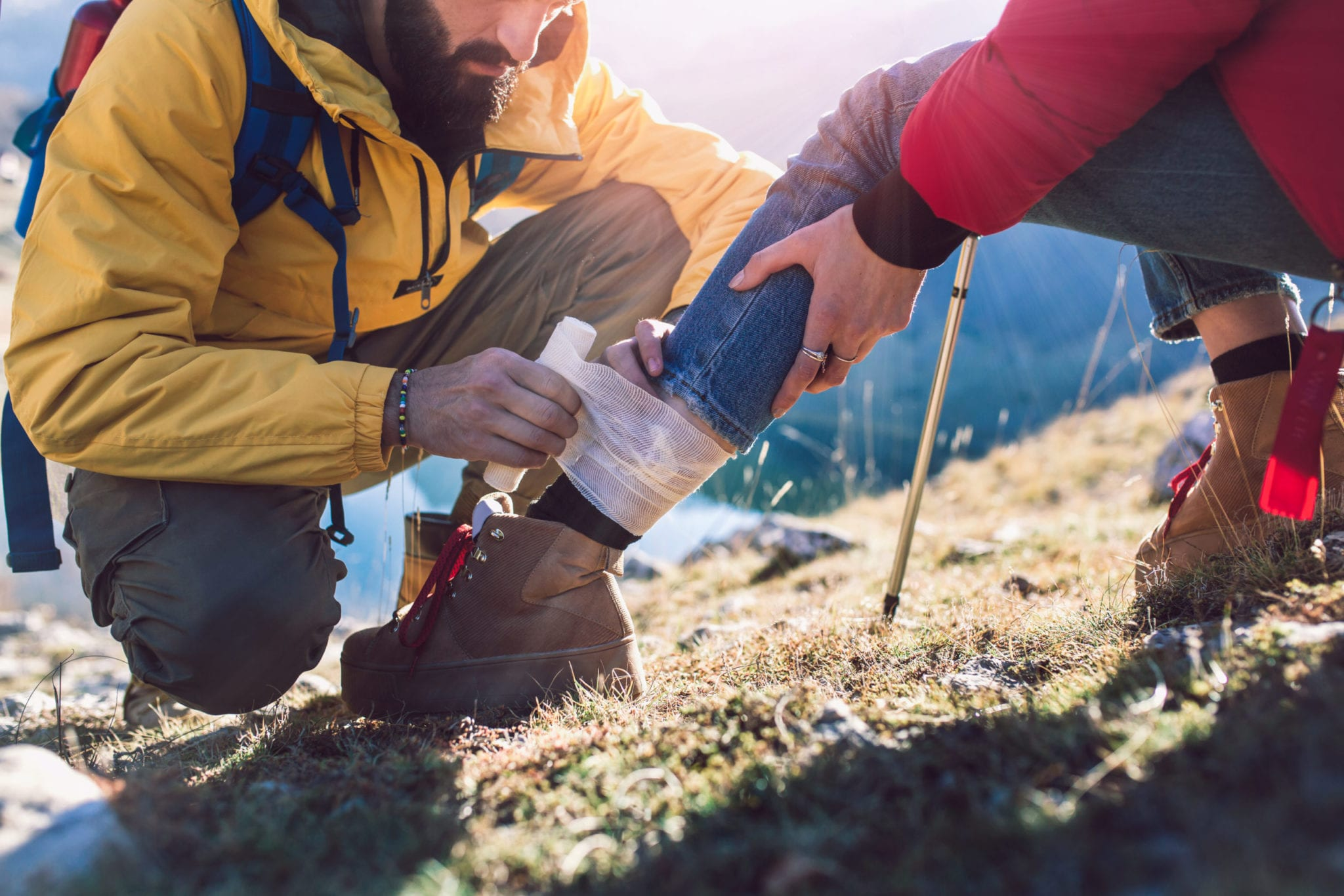 hiking essentials - hikers doing first aid