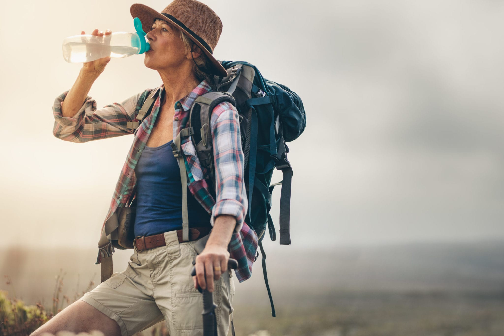 hiking essentials - woman drinking water