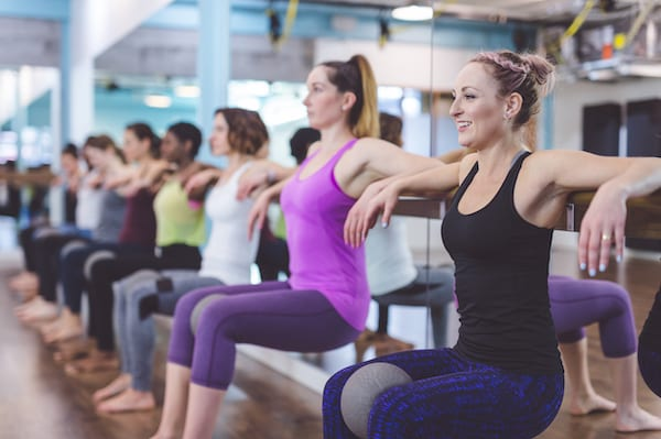 legs shaking barre - women doing barre exercises