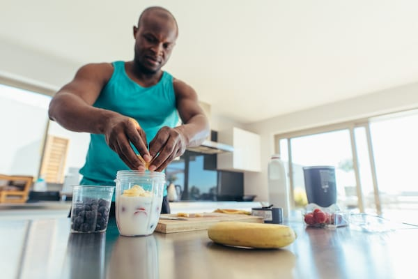 protein shake for breakfast - man making shake