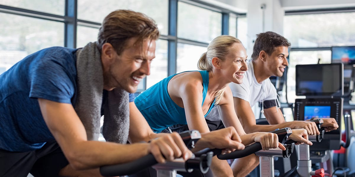 biking burning calories - people on indoor bikes