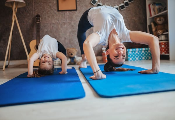 working out social distancing - yoga with kids at home