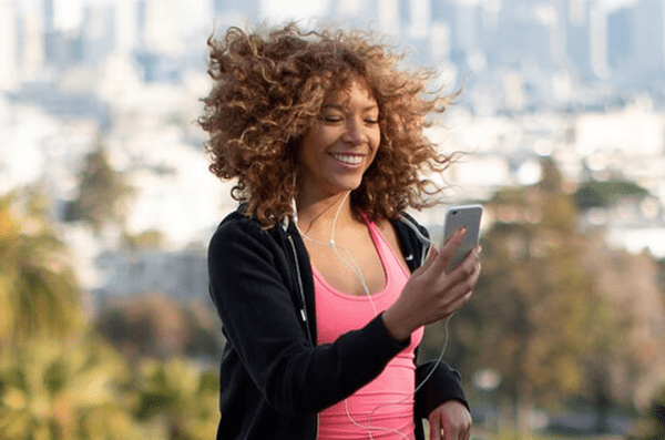 openfit running workout - woman running with phone