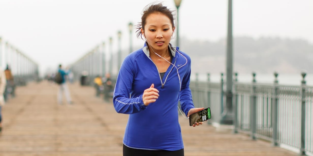 openfit running workout - woman with phone