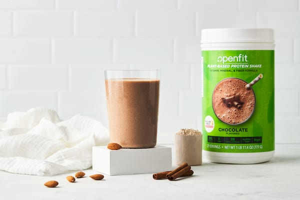 spiced almond shake - shake in glass with protein container