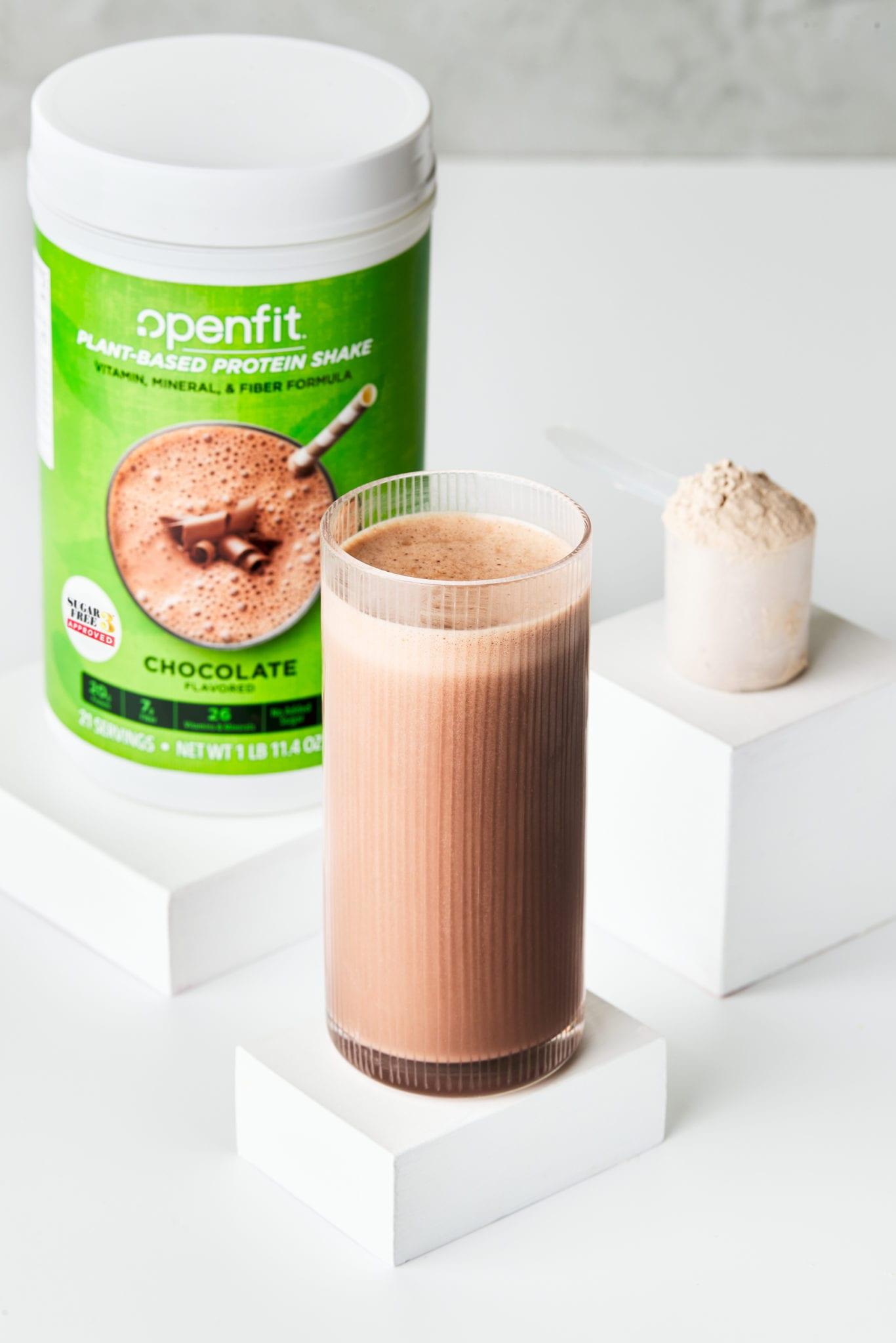 plant based protein shake - drink powder and container