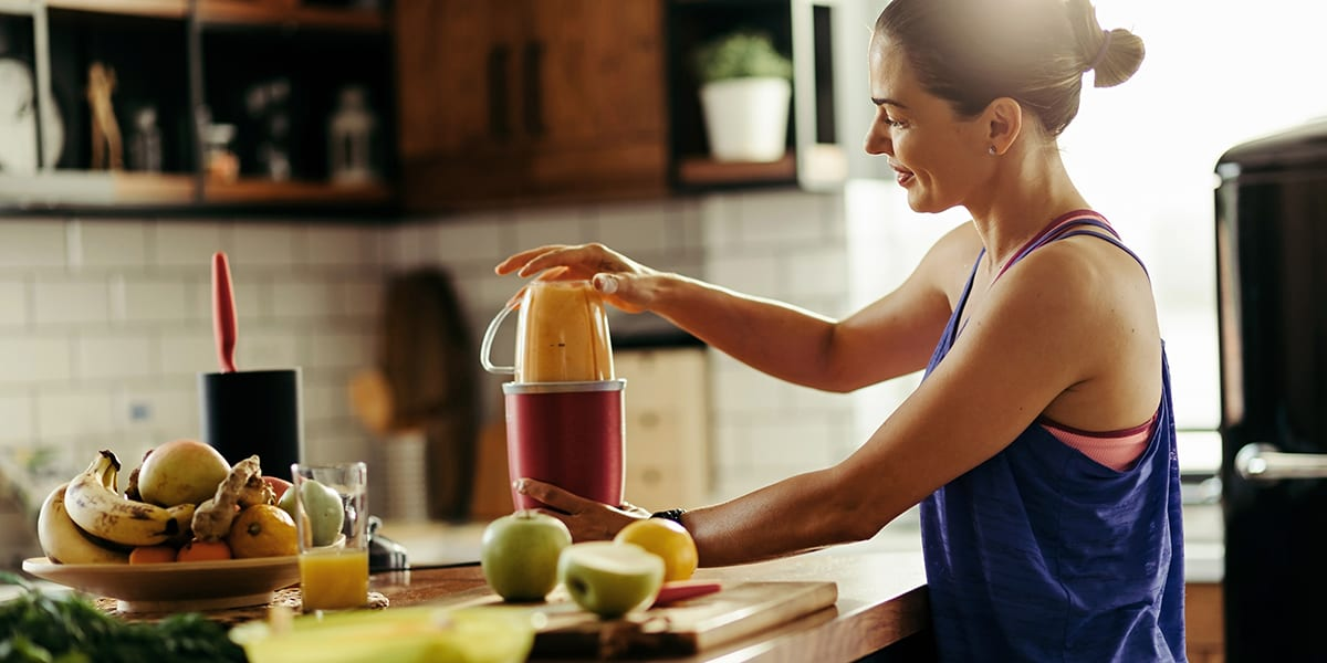 benefits of protein shakes - woman making protein shake