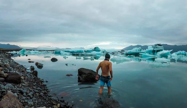 wim hof breathing - man walking into icey water