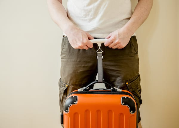 stay fit indoors - holding a suitcase