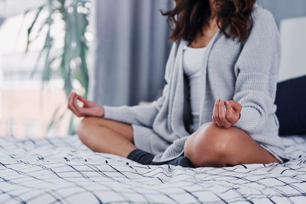 sleep tips for stress - meditating in bed