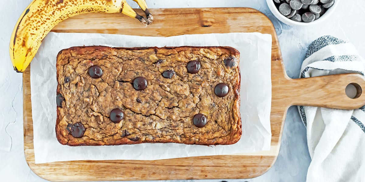 chocolate chip banana bread - loaf of banana bread on board