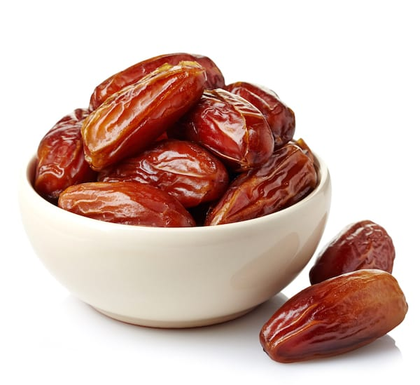 benefits of dates - dates in bowl on white