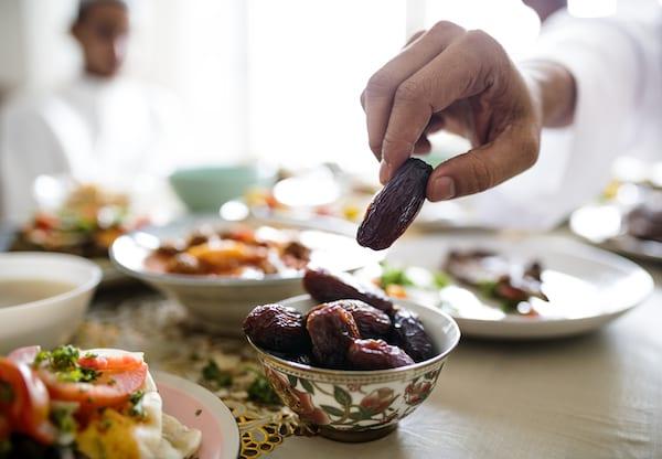 benefits of dates - man eating dates