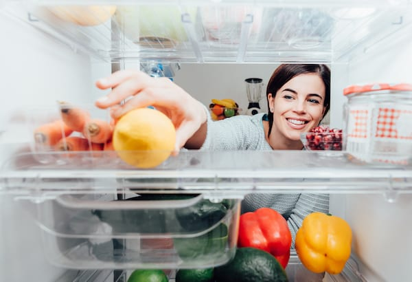 vegetable storage - woman reaching in fridge