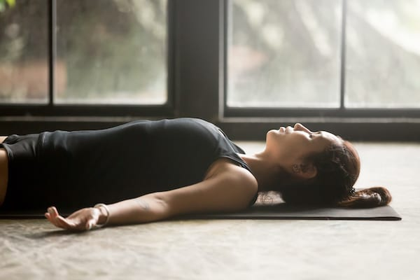 breathwork - woman breathing on yoga mat