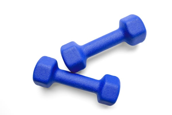 workout with light weights - pair of light weights on white