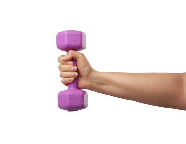 working out with lighter weights - woman hand holding light weight