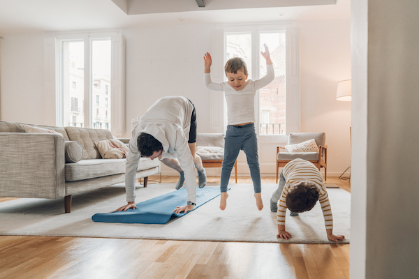 workout with kids - father and kids doing stretches