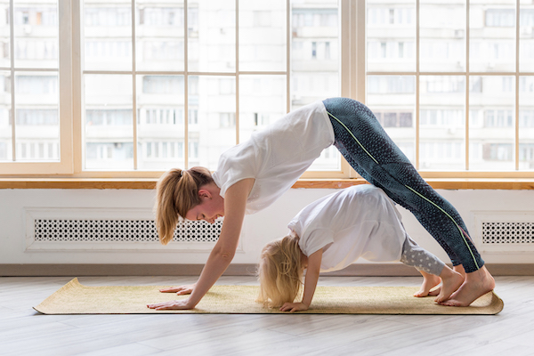 workout at home kids - mother working out w kids