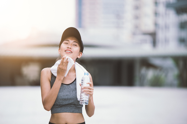 exercising in the heat - woman sweating outside