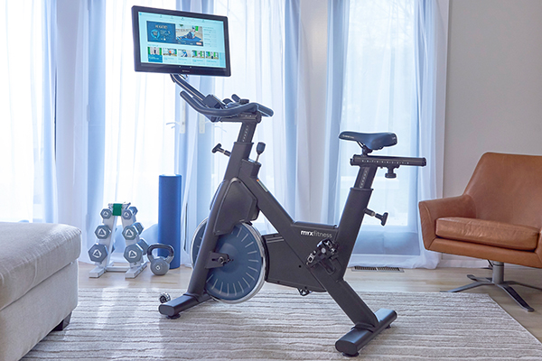 myx fitness bike with dumbbells at home gym