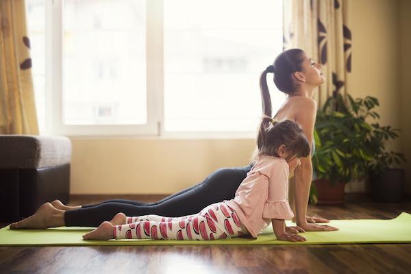 kids yoga - kid and woman doing yoga