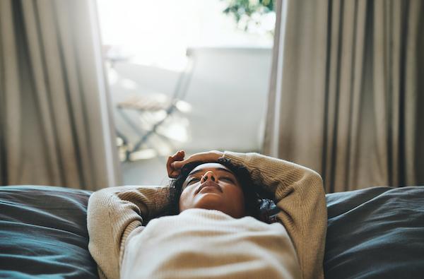 sleep meditation - woman laying in bed