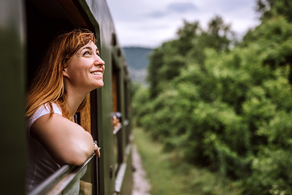 smiling woman looking at nature | benefits of being outside