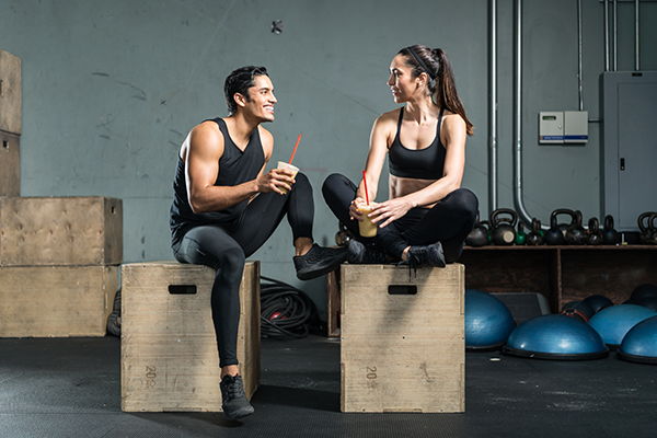 fitness couple drinking protein shake | whey protein