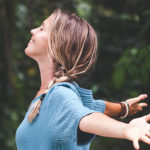 woman outstretch arms outside | benefits of being outside