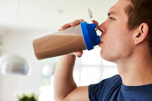 man drinking protein shake | whey protein