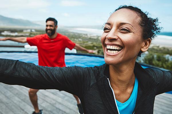 couple smiling doing yoga | yoga and meditation