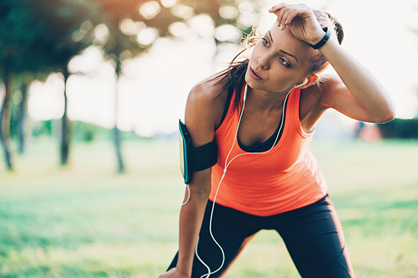 woman resting after exercise | how many grams of protein do you need after a workout