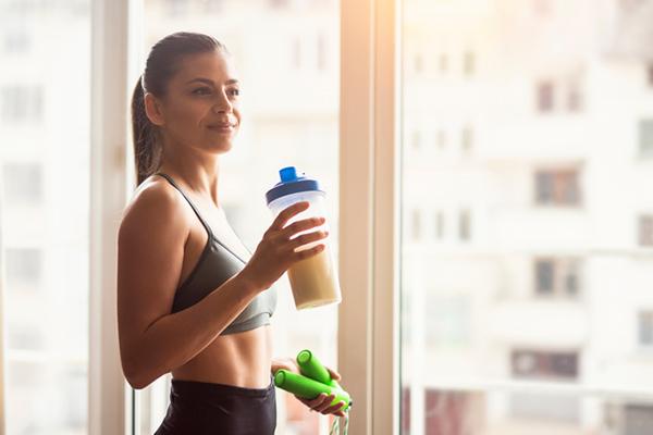 woman drinking protein shake | best protein powder