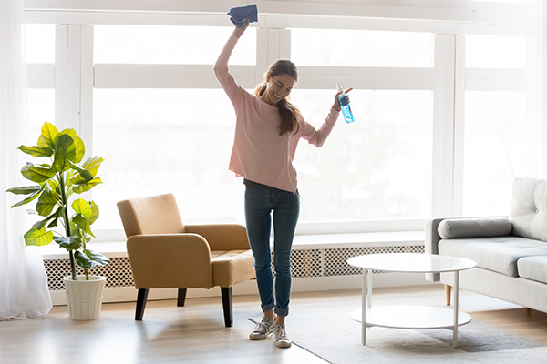 woman dancing while cleaning | NEAT exercises