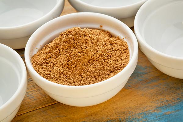 bowl of camu camu powder on table | camu camu