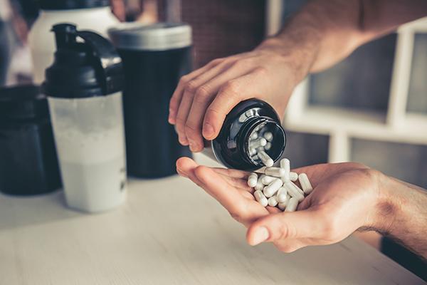 bottle of creatine pills | pre workout supplement